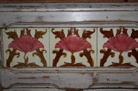 Tiles inlaid into a wooden bar